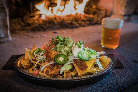 Westport, CT: Nachos: corn tortilla chips smothered w/ cheddar-jack & American cheese, lettuce, jalapeñ
