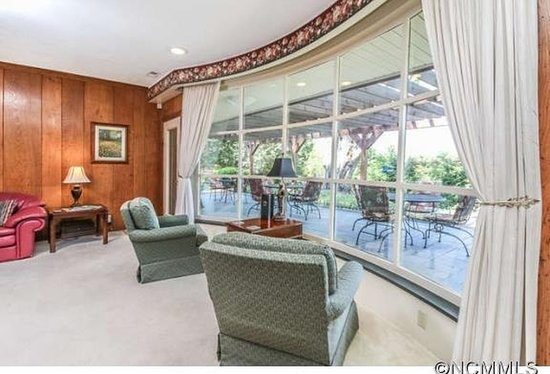 Waynesville, NC: Oversized, bowed window in family room overlooking mountains