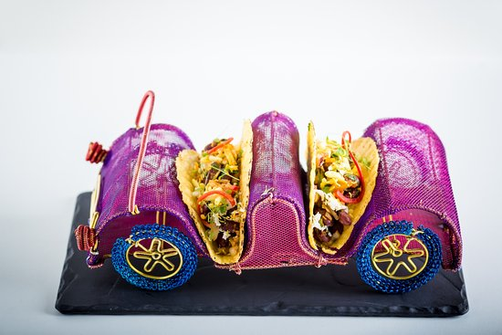 Gaylord Restaurant: Desi tacos - Drive in a colorful toy car