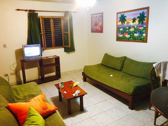 Acuarium Resort Hotel: Living Room with dining table (four chairs)