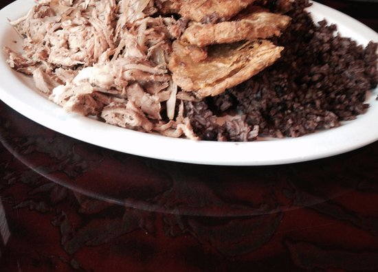 Burtonsville, MD: Rice and red beans with shredded chicken garnished with flattened  fried green plantain