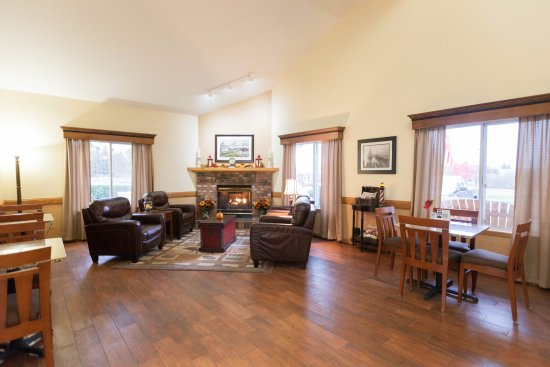 Country Inn of Two Harbors : Relax by the lobby fireplace