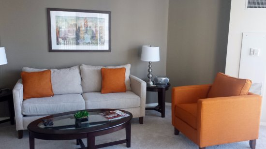 Manilow Suites at The Grand Plaza : A fully furnished Manilow Suites apartment living room.