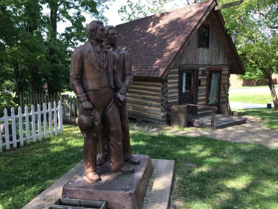 Nauvoo, IL: statue and cabin in historical village