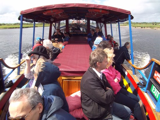 Athlone, Ireland: looking back into the boat. Inside seating at the rear.