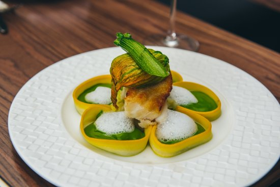 Woodford, UK: Pan seared cod, courgette flower, mint