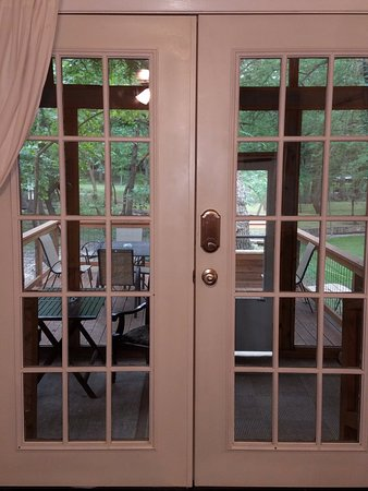 French Doors Off Living Room Leading To Screened In Hot Tub Porch