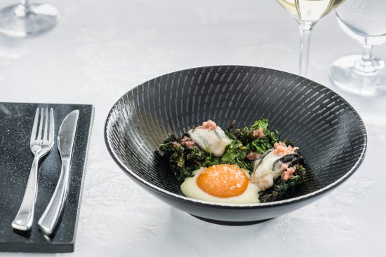Pescatore: Slow cooked egg yolk, smoked potato, kale, oyster dressing