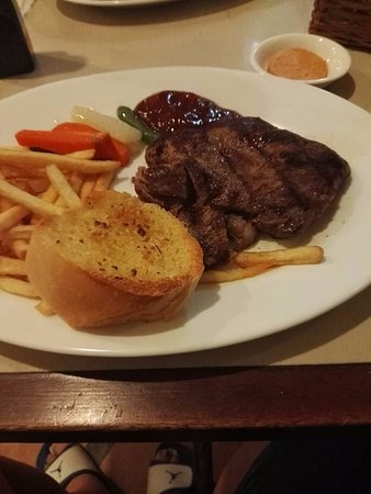 US angus tenderloin steak aith french fries and garlic bread at the Swiss deli