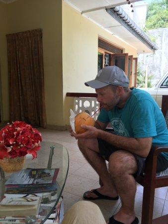 Mawanella, Sri Lanka: guest having his welcome drink
