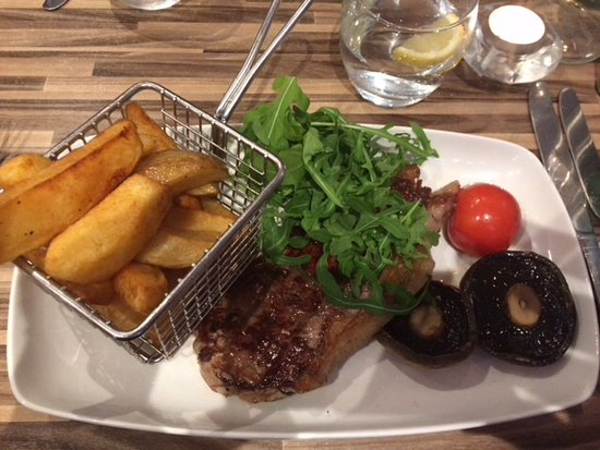 "Desborough, UK: Sirloin Steak served with chips and a ""crisp salad"""