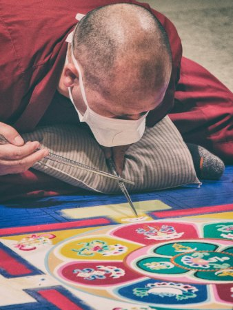 Tequesta, FL: A monk works on the mandala