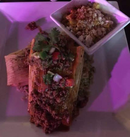 Addison, تكساس: Pork tamales (2) on cilantro lime rice with corn elote on the side