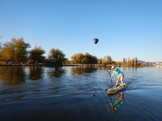 Caveman Yoga : When sup yoga goes bad ; picture of the sup'ing caveman canberra