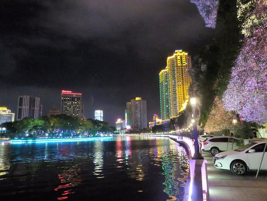 Zhongshan, China: Colorful lights outside the hotel on the river bank