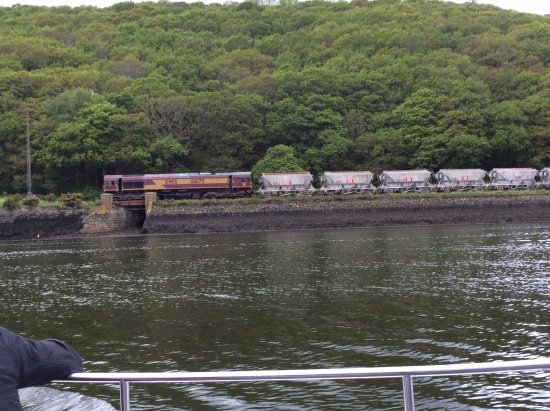 Fowey, UK: China clay train, seen from the estuary tour boat