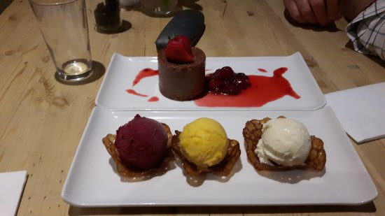 Box, UK: Delicious! My goat's cheese tart and shared puds. Blackcurrant sorbet, mango sorbet and vanilla
