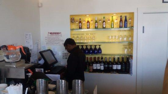 Woburn, MA: Cashier corner and wine bottles