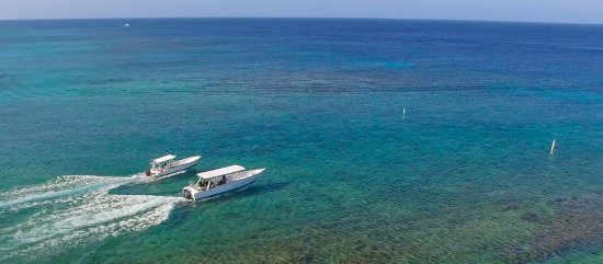 West End, Honduras: Roatan Divers' boats, Ran and Saga, heading out for a dive!