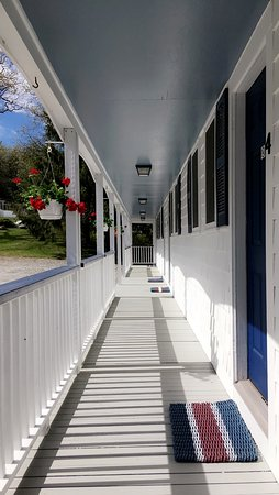 Lincolnville, ME: Inn, Cottages, or Motel. The Motel Building with spacious rooms and water views from the deck.