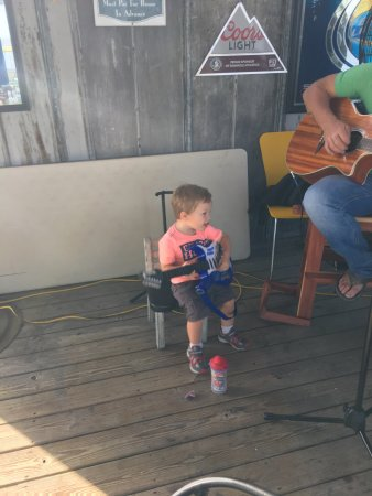 Eastpoint, FL: Young man nice voice singing & playing guitar,his almost-2yr.old played along, tapping his feet
