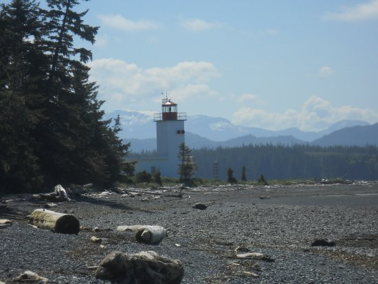 Malcolm Island, Canada: Lighthouse set against the windswept beach and distant mountains
