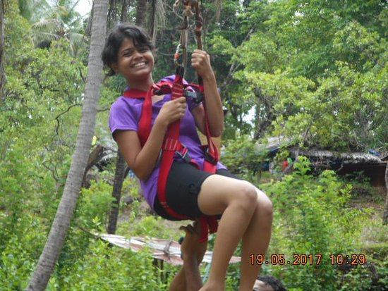 Sancordem, India: One of the children from the group doing the zip line