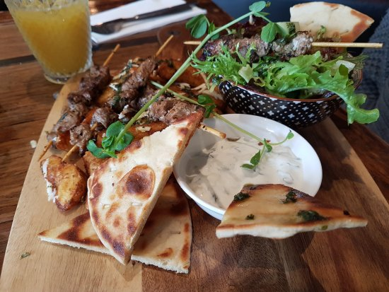 Thirroul, Australia: Seasoned lamb skewers with tzatziki
