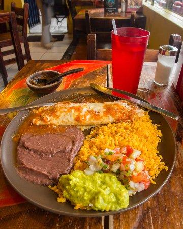 Jalapenos Central: Chicken enchilada, rice, beans, guacamole,pico de gallo, mixed fruit drink