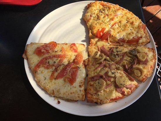Ventspils, Lettland: Three different slices of pizza - garlic, margarita, mushrooms
