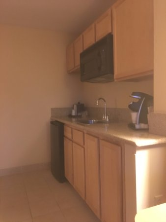 Fremont, CA: kitchenette-refer holds a 12-pack easy, keurig coffee and sink with microwave.