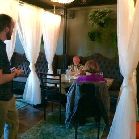 Plover, WI: In one of the neat sectioned off places in the restaurant. Brandon, our server is in the pic.