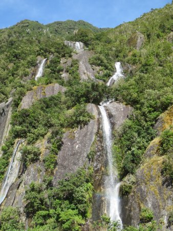 Franz Josef, New Zealand: One of the many waterfalls along the trail.