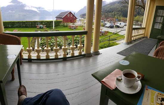 Walaker Hotell: Enjoying a cup of coffee and my book from the front porch, overlooking the fjord.