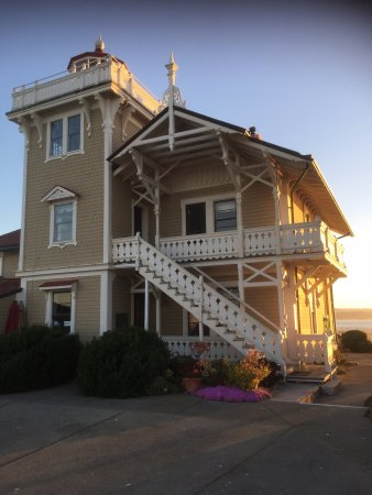 Point Richmond, CA: Sunset view of main building, light at top.