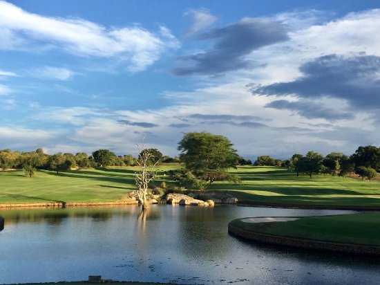 Malelane, África do Sul: Clubhouse view of 9th and 18th fairways after golf.
