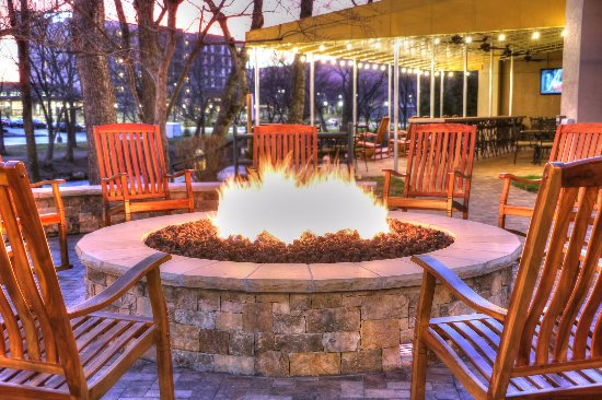 The Inn On The River: Fire Pit Area, Rocking Chairs, Relax Enjoy The