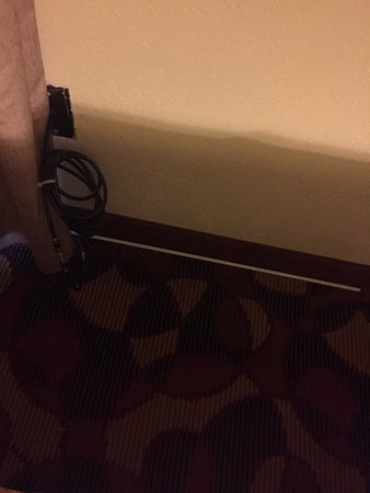 Days Inn by Wyndham Carlisle PA: Curtain draw rod on the floor and nice spool of cable for a kid to play with!