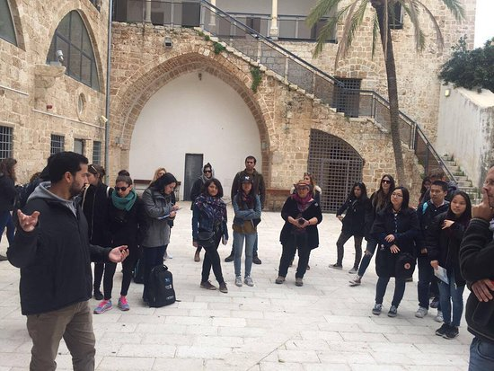 Acre, Israel: Wisam is giving our Italian guests a thorough understanding of the many layers of the Saraya