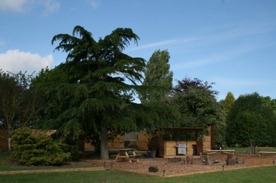 Communal area with warming firepit, Suffolk Glamping with fire pit, hot tub and sauna.