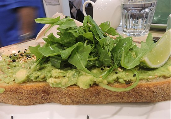 Lennox Head, Australia: Smashed Avocado with Rocket on sourdough bread