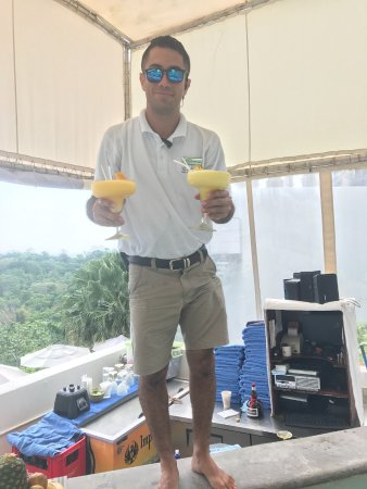 Gaia Hotel & Reserve: This is the bartender at the pool, literally handing us drinks in the pool!