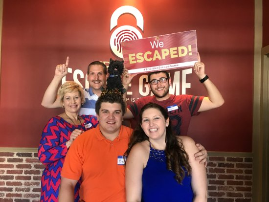 Bristol, TN: Birthday boy and his wife in front, me in the middle, wife on left & son holding Escape sign.