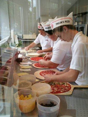 A & A Pagliai's Pizza : Hard at work making my dinner!!