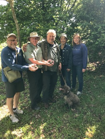 Citta di Castello, Italy: Truffle hunters with hands full of truffles found by Camillia (dog)
