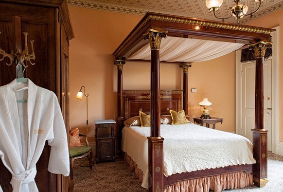 Vevay, IN: While in Corinne's Room, rest in the Philadelphia Empire queen bed with full canopy.