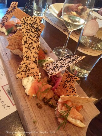 Mercer Hall Inn: House Smoked Salmon Board: Herbed chèvre, rye crackers, pickled red onion, fried capers, salmon