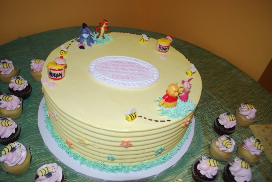 Winnie the Pooh baby shower cake with mini cupcakes Picture of