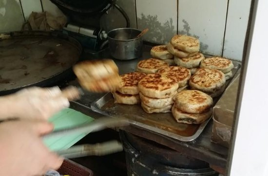 Small Group 4-Hour Gourmet Beijing...