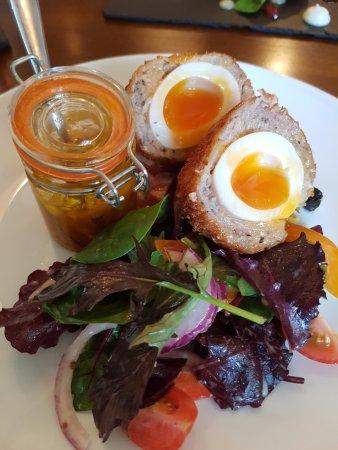 Sawbridgeworth, UK: scotch egg with black pudding, bacon and chutney starter was A-MAZ-ING!!